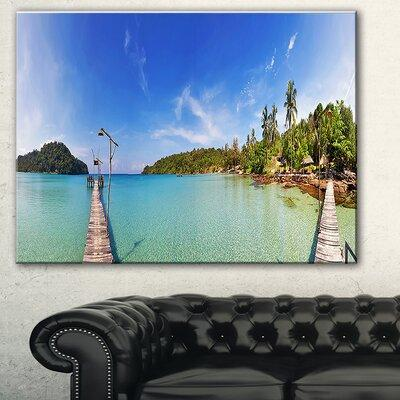 DesignArt 'Piers and Palm Trees on Island' Photographic P...